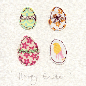 four stitched fabric eggs handmade card