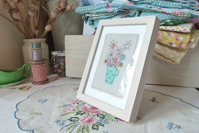 small framed handmade textile picture of flowers
