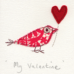 red and white patterned paper bird with red felt heart balloon handmade card