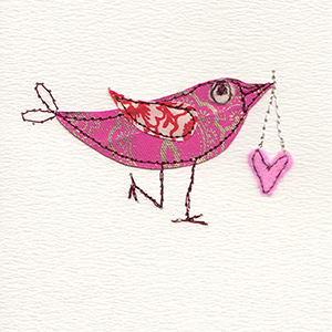 stitched paper valentine bird with fabric heart hanging from beak handmade card