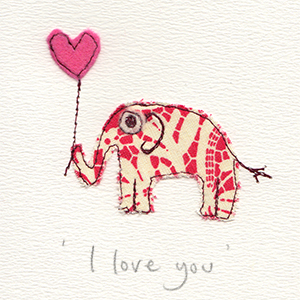red and white patterned paper stitched elephant with pink felt heart balloon