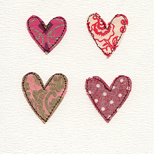 four patterned paper stitched hearts handmade card