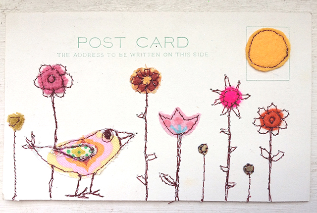 embroidered bird and flowers on postcard
