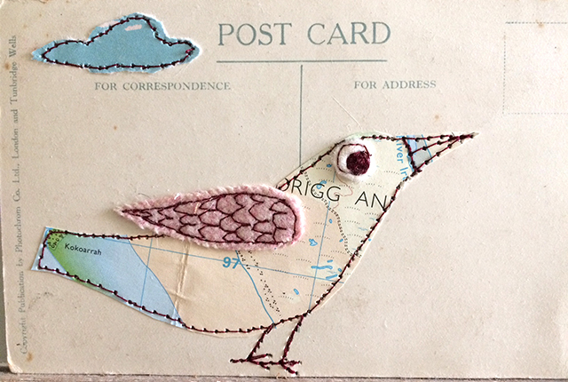 embroidered map bird on postcard